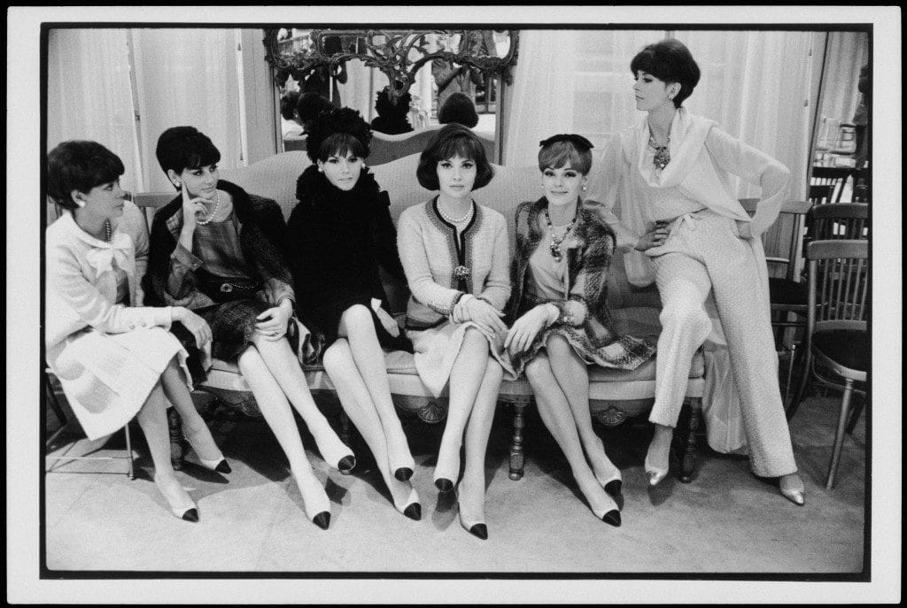 Italian actor Gina Lollobrigida surrounded by models wearing the two-tone shoe